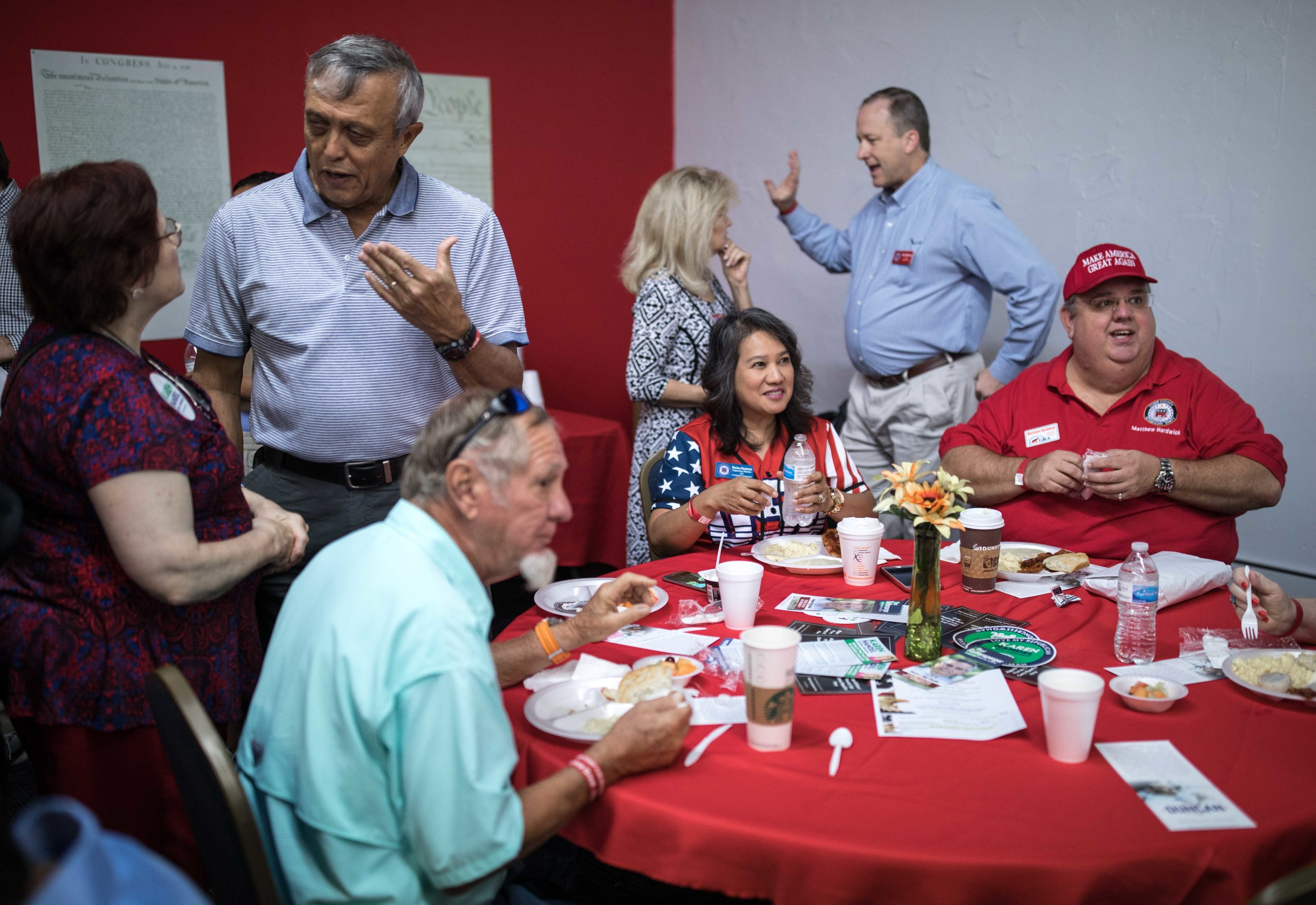 Cobb County Commission Chairman Mike Boyce, left, talks with a woman during a breakfast meet and greet at the Cobb County GOP headquarters, Saturday, Oct.6, 2018, in Marietta, Ga.