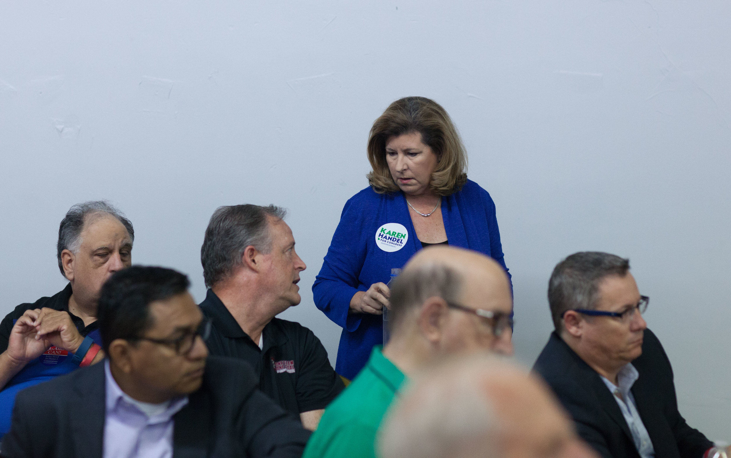 Rep. Karen Handel greets guest during a breakfast meet and greet at the Cobb County GOP headquarters, Saturday, Oct.6, 2018, in Marietta, Ga.