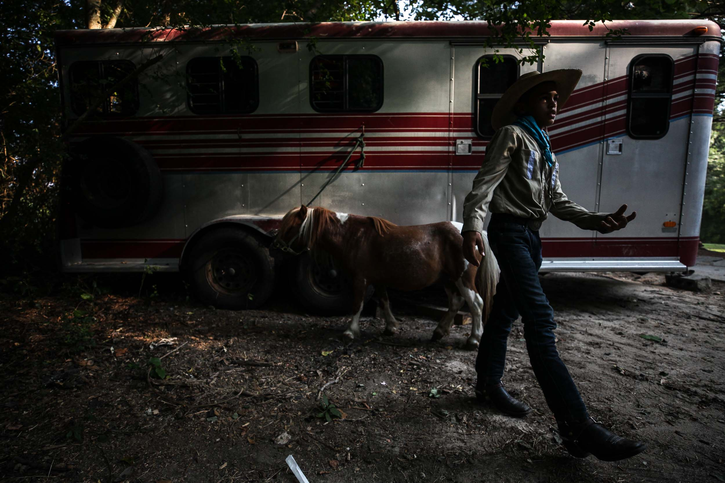 Logan Dansby, 12, walks away from his pony on a ranch off of Flat Shoals Parkway, Tuesday, July 30, 2019, in Union City, Ga. Branden Camp for AJC