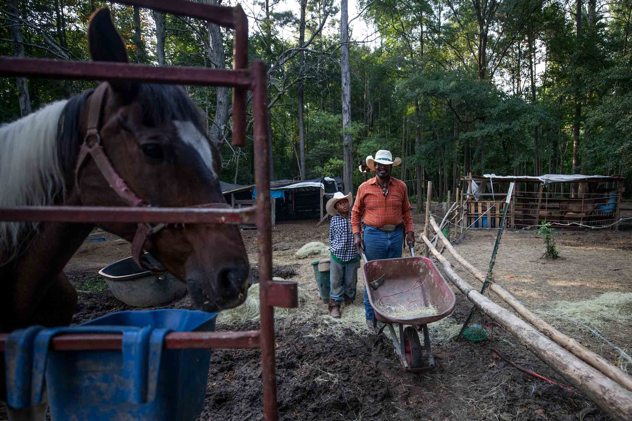 Billy Ray Thunder and his grandson Justin Brown, 11, feed the horses on his ranch off of Flat Shoals Parkway, Tuesday, July 30, 2019, in Union City, Ga. Branden Camp for AJC