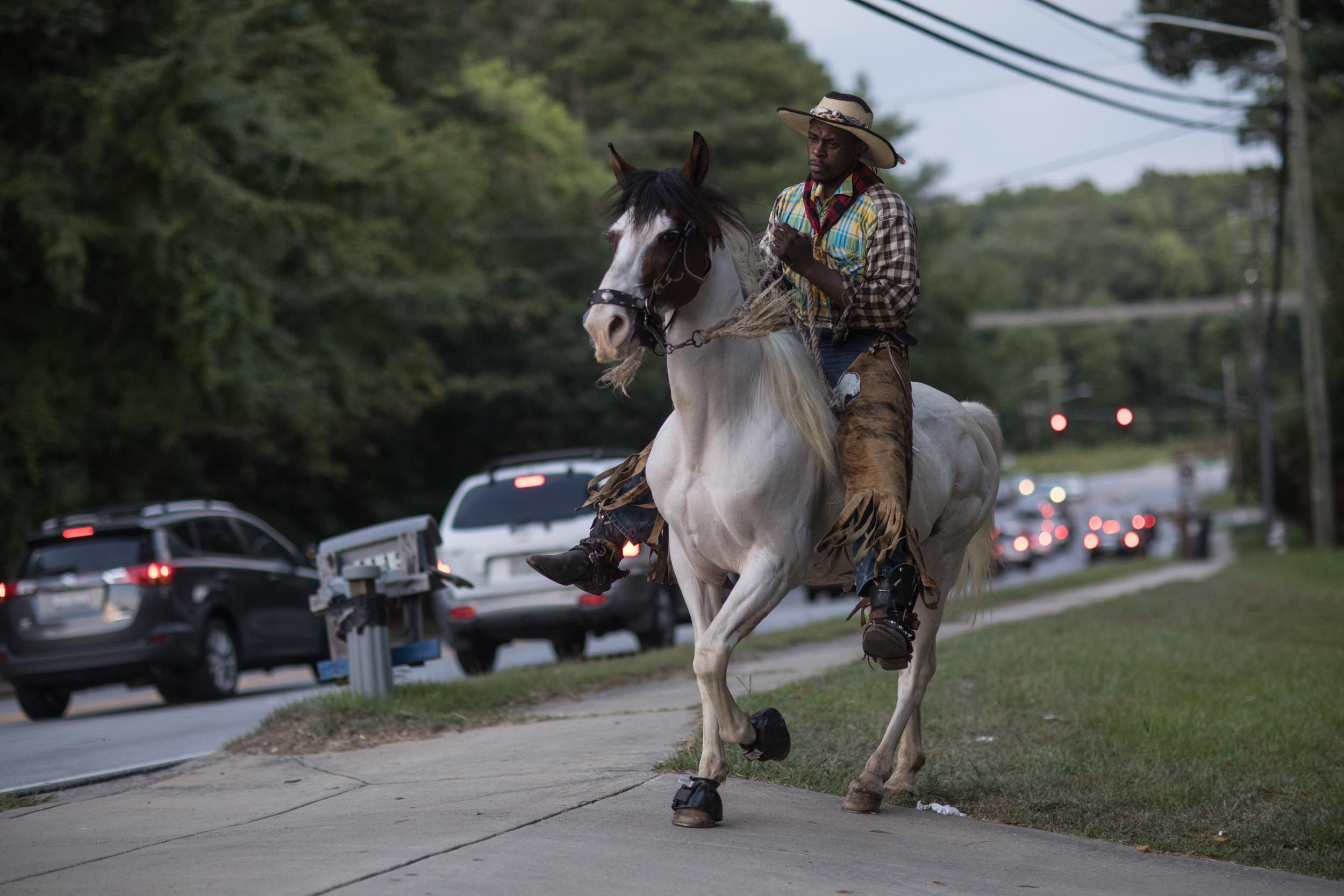 Arkansas Dave rides his horse on a ranch off of Flat Shoals Parkway, Tuesday, July 30, 2019, in Union City, Ga. Branden Camp for AJC