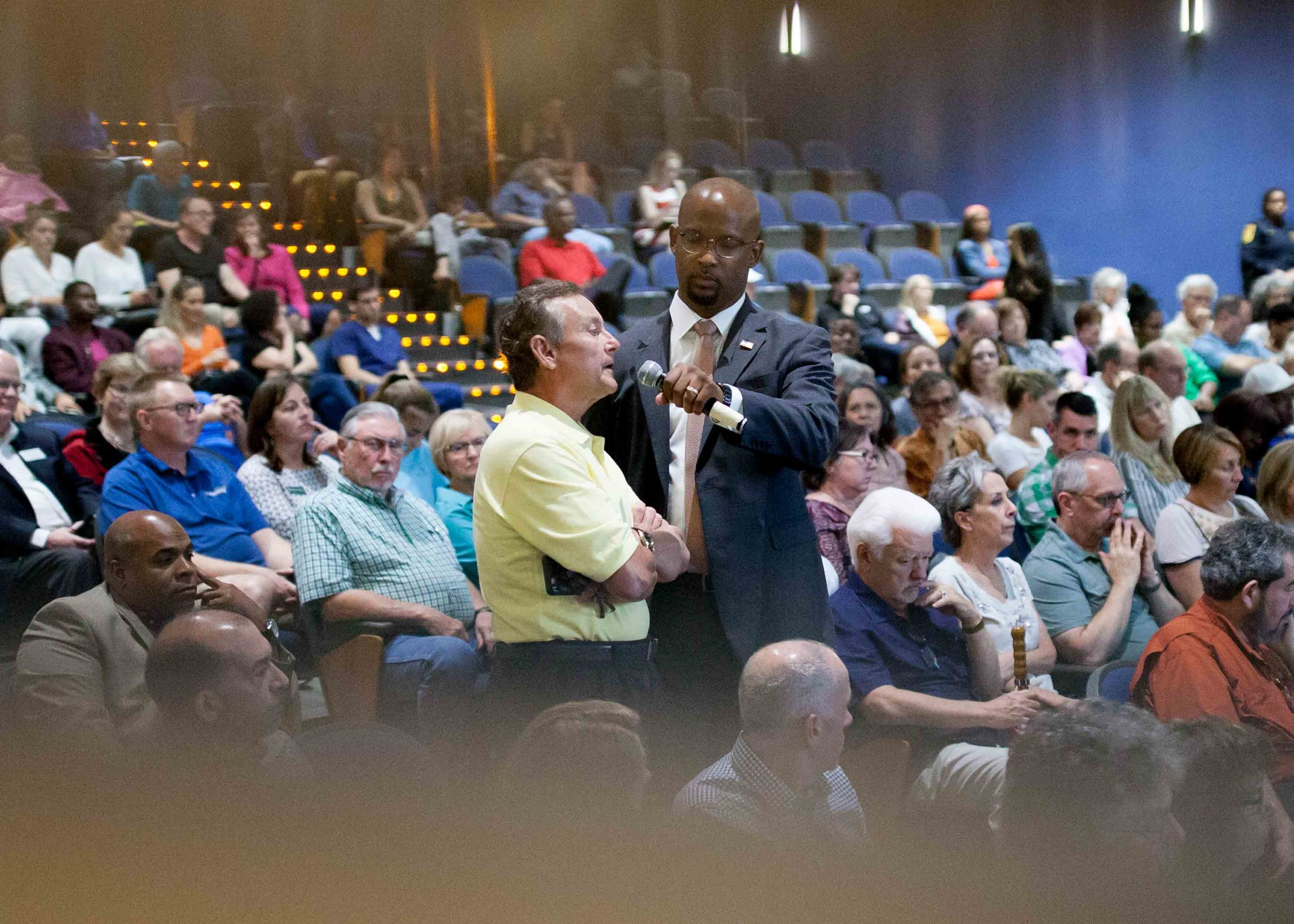 A man asks Rep. Lucy McBath, D-Ga., a question during a town hall at Dunwoody High School on Saturday, June 8, 2019 in Dunwoody, Ga. Branden Camp for AJC
