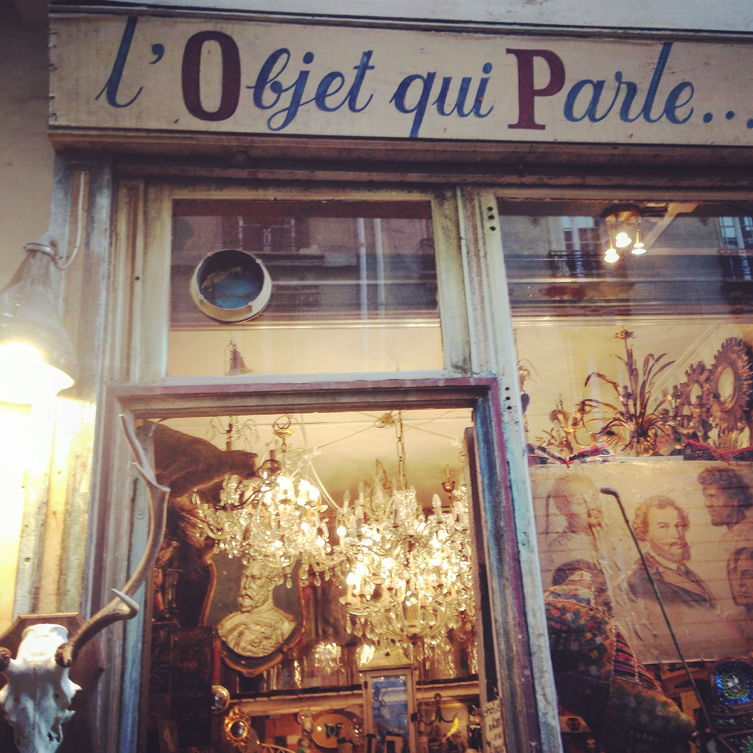 One of the best things about Paris is that you never quite know what you'll stumble on next. Vintage is always just around the corner. Paris is the kind of place where you can be wandering in a super chic modern shopping centre one moment and browsing vintage the next. Cue: L'Objet qui Parle.  You know those shops that you enter on a whim and end up staying for hours? Well, that's exactly what happens when you enter  l'Objet  qui Parle  for the first time. In French, ' l' Objet qui  Parle ' literally means 'the talking object'. This is a pretty fitting name considering that's  just what the unusual wares do. Each carefully curated item in the store has its own individual story, history. Think clay smoking pipes next to plastic doll heads. Think quirky mirror frames next to pencil sketches.  The shop is laid out like a curiosity shop of the past. Everything is arranged in a ' n'importe quoi'  style and you have to 'dig' through wares to find gems. Although  the Old Curiosity Shop in London  is now a luxury shoe shop, this is how I love to imagine it would have looked back in the day. What I'm trying to say is that, when I open my own antique shop ( a very probable future occupation ), this is how you can expect it to look!