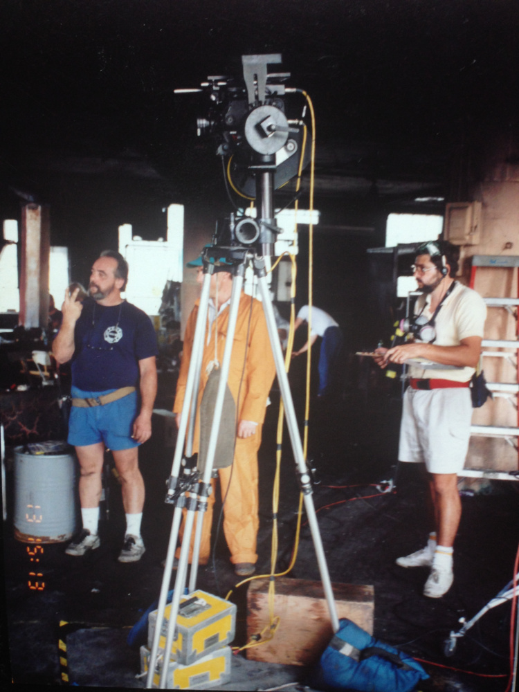 On the set of  Backdraft . In the burned out mannequin factory. I'm standing next to my 1st AD, Bruce Moriarty who is hiding behind the tripod. Tom Ryba, Special Efx Coor. for 2nd unit is on the left.