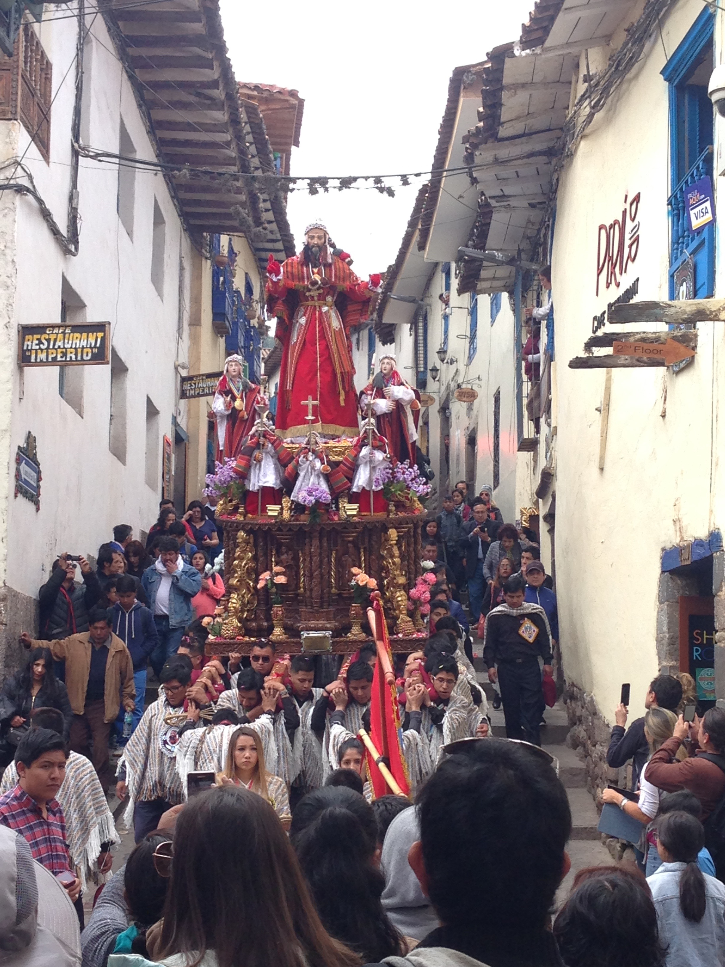 A Saint on a pedestal in the streets of Cuzco during the festival of Corpus Christi.