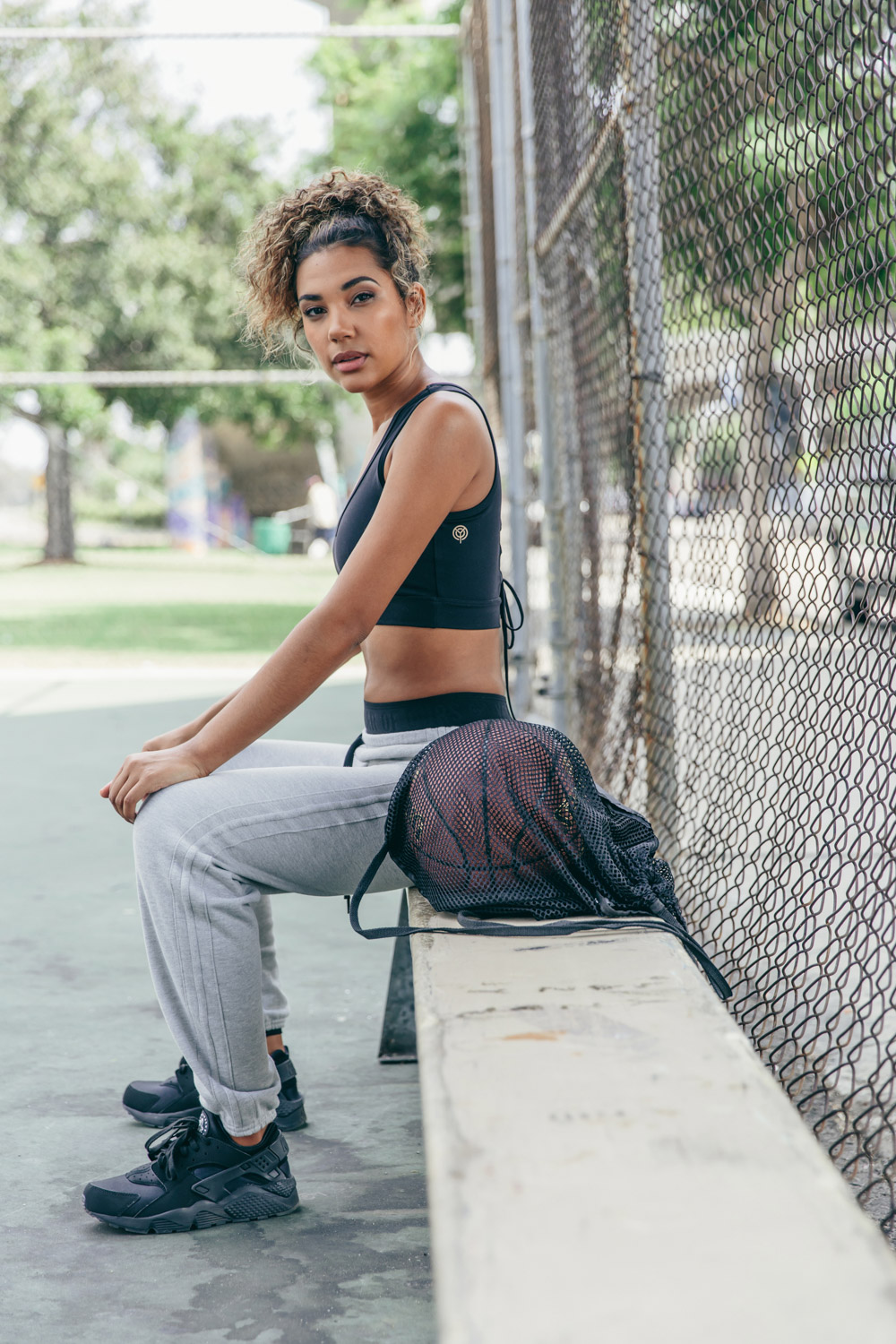 Year of Ours Sports portraits by Jenny Siegwart: Woman in sports bra on the basketball court