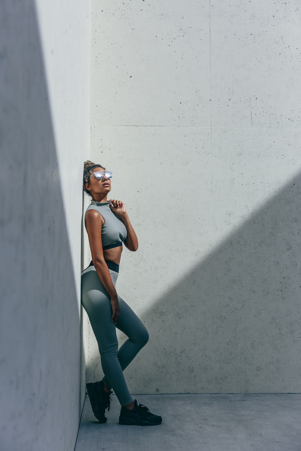 Year of Ours Sports portraits by Jenny Siegwart: Woman leaning against the wall