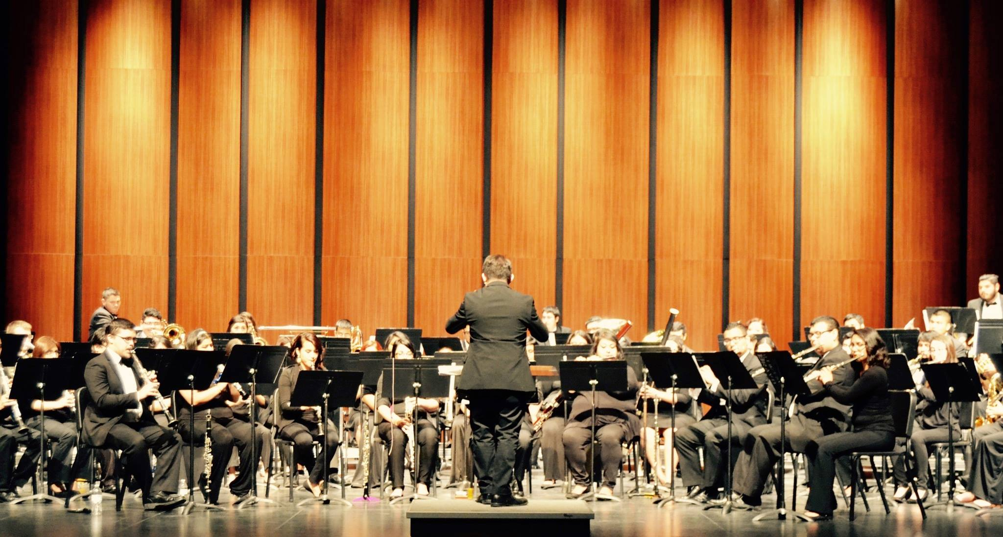 Here is Mathew conducting the world premiere of his piece,  Into the Void,  with the UTRGV Wind Symphony in April 2016. (PC: Iris Gracia Campbell)