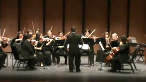 Here is Mathew in his debut as a composer / conductor conducting his piece,  Simple Gifts . Photo Credit: Dora Gutierrez Campbell (in whopping 240p resolution - Thanks 2011.)