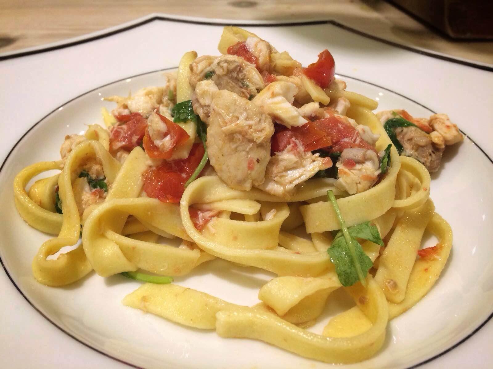 Fresh pasta with wild sea bass, rocket & tomato