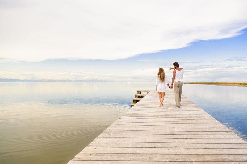 couple-walking-along-a-boardwalk