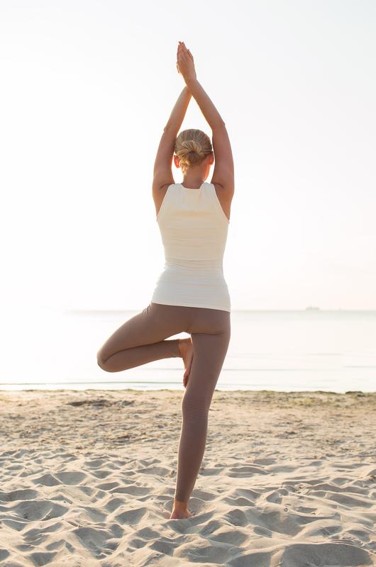 woman-yoga-on-beach