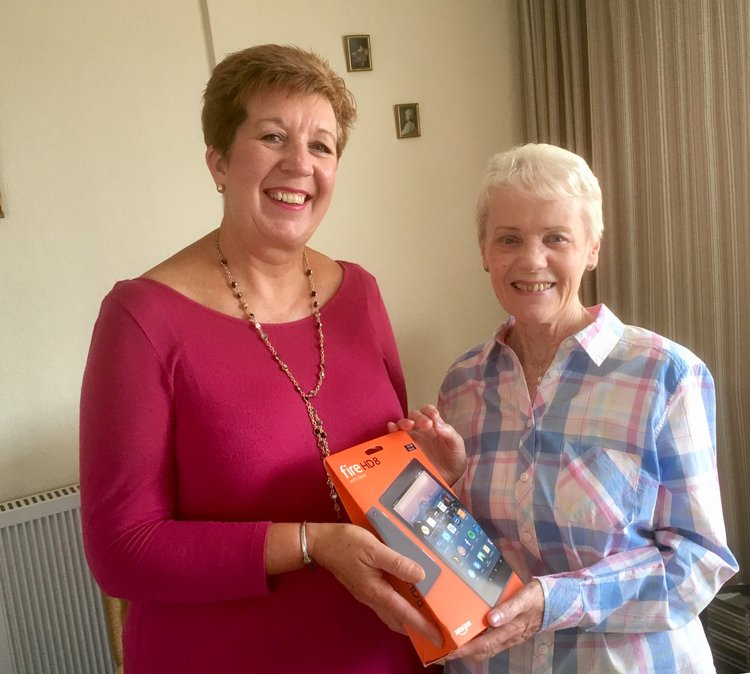 LEANOR MCGUCKIN, TB TRAINING OFFICER, PRESENTS JEAN WITH HER NEW TABLET.
