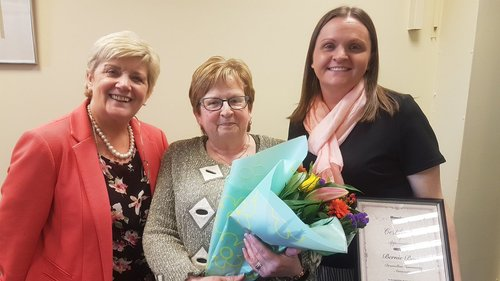 Bernie Burns (centre) on her retirement with Denise McNally, Housing Executive (left) and Siobhan ONeill, Supporting Communities (right).