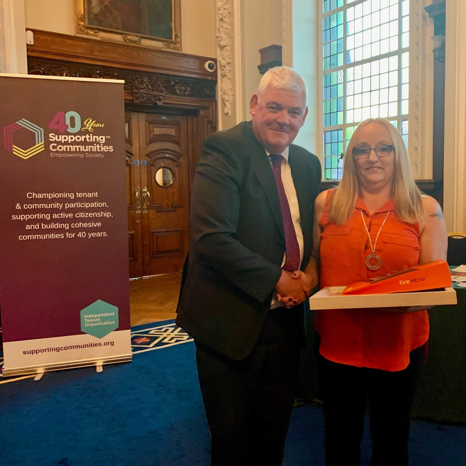 "Andrea Whiltshaw recieves the ""Excellence in Learning"" Award presented by Colm McQuillan from the Housing Executive."