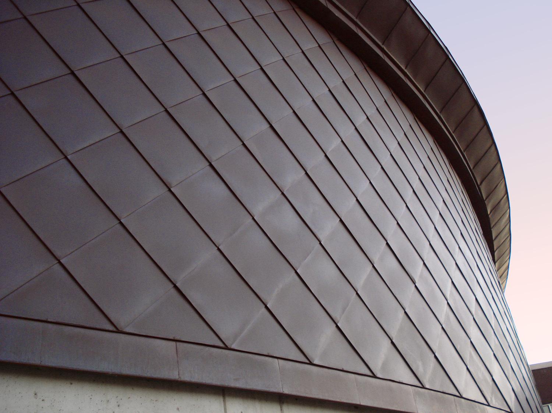 Oramental metal roof by Huber & Associates