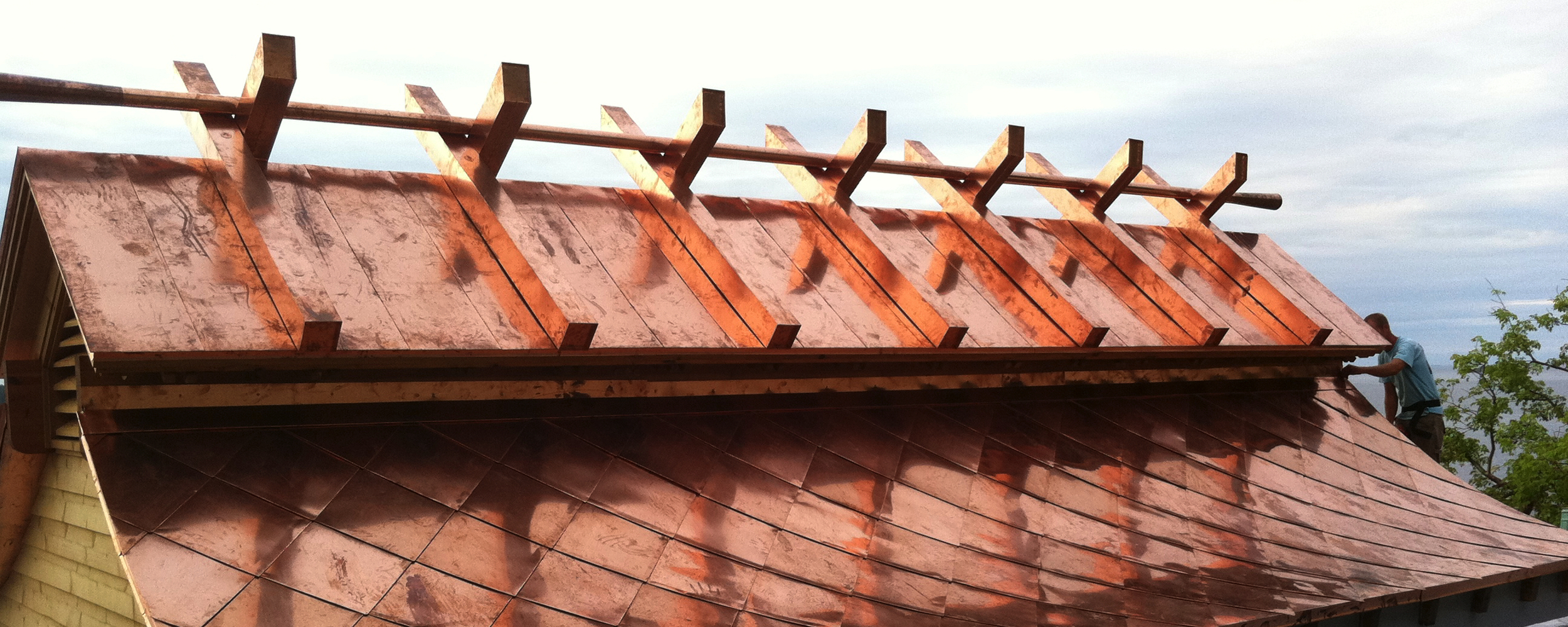 copper cornice on a custom roof by Huber & associates