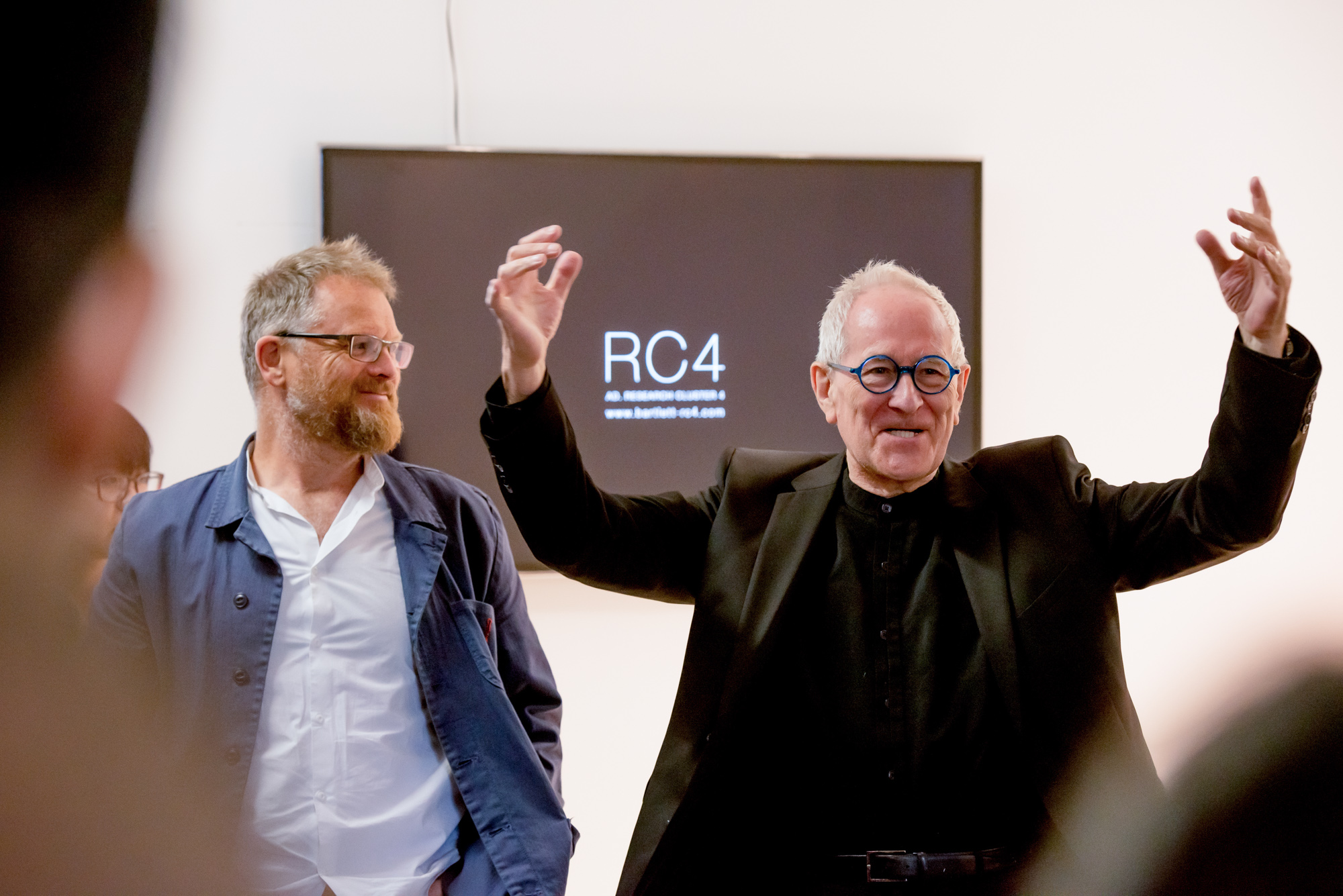 Peter Cook speaking to new students at 2015 B-Pro Exhibition. Bartlett School of Architecture, UCL, 140,Hampstead Road, London. Photography by Richard Stonehouse