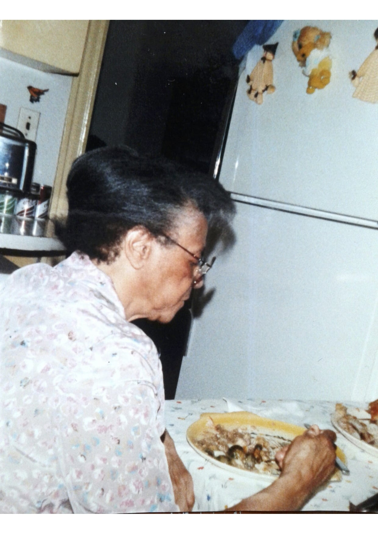 Granny at the kitchen table.