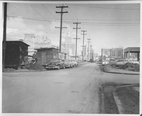 """Perdido Street in front of new City Hall toward Loyola Avenue """"before"""" widening.Dated March, 1957.From the New Orleans Public Library Archives ."""