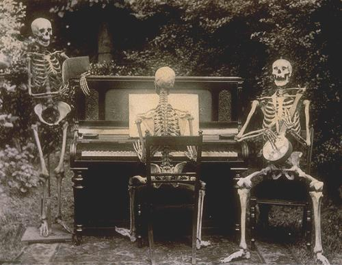 Three skeletons at the piano. Description: Photograph of three skeletons, one seated at piano, one playing banjo, one singing. Garden scene. No 1. Date: 1893. Our Catalogue Reference: COPY 1/411/21. This image is from the collections of The National Archives UK.