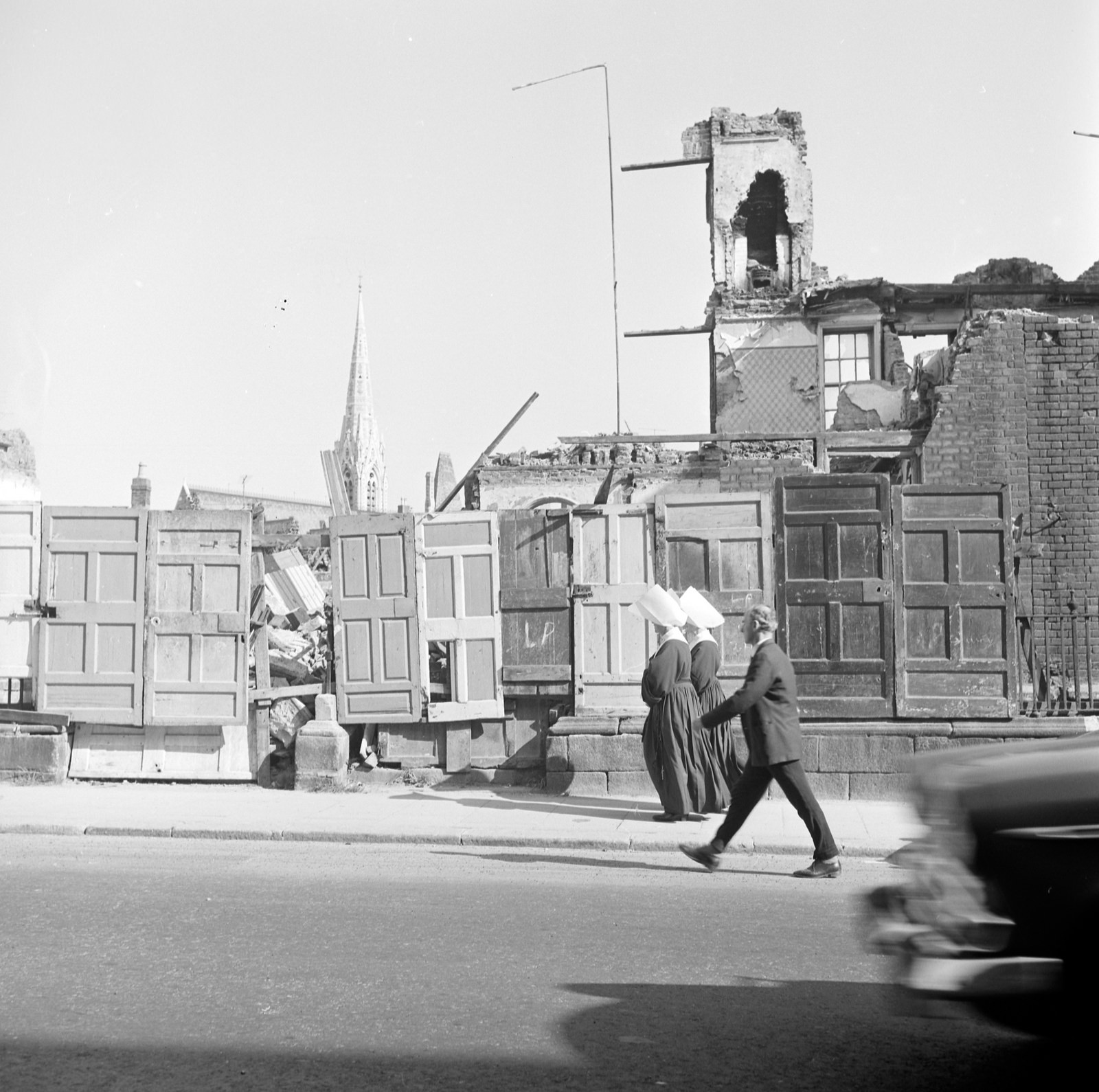 Photograph from the  National Library of Ireland : A more modern shot with many signals of times past! The makeshift hoarding versus todays mandatory fencing and most of all those nuns with those enormous headpieces on display. With thanks to O Mac and sharon.corbet we know that this was likely a shot of the much debated demolition works at Dorset Street on the northside during the summer of 1964. Photographer: Elinor or Reginald Wiltshire. Collection: Wiltshire Photographic Collection.