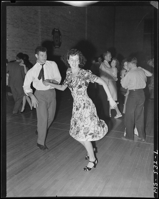 Young couple dancing at VFW dance on occasion of Fourth of July celebration. Price, Carbon County, Utah. U.S. National Archives' Local Identifier: 245-MS-532L. From:: Photographs of the Medical Survey of the Bituminous Coal Industry, compiled 1946 - 1947. Created By:: Department of the Interior. Solid Fuels Administration For War. (04/19/1943 - 06/30/1947) Production Date: 07/03/1946.