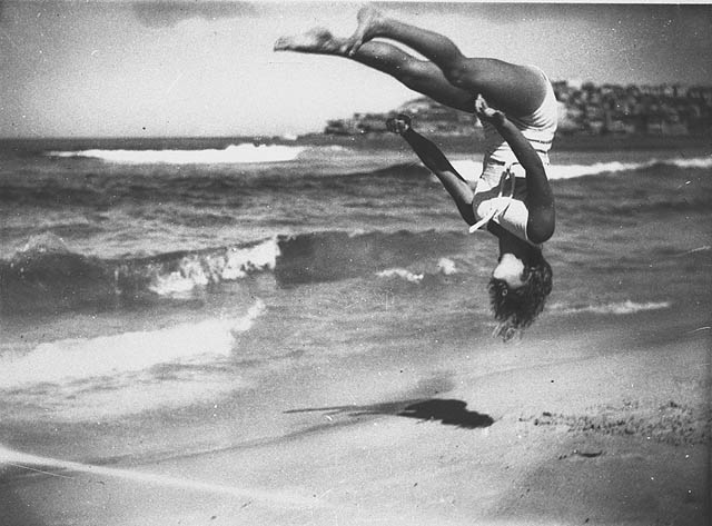Peggy Bacon in mid-air backflip
