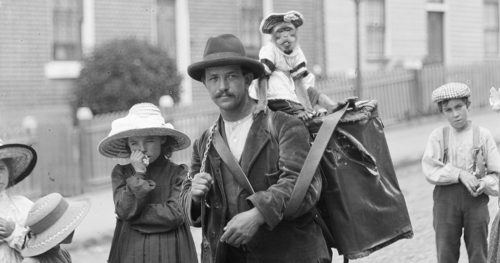 TItle: Man with Monkey and Children (c1900) from the Tasmanian Archive and Heritage Office: Detail from NS1013-1-1269.