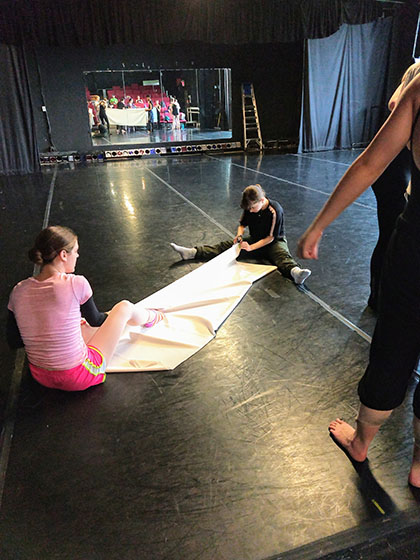 dance students working with props before performance.jpg