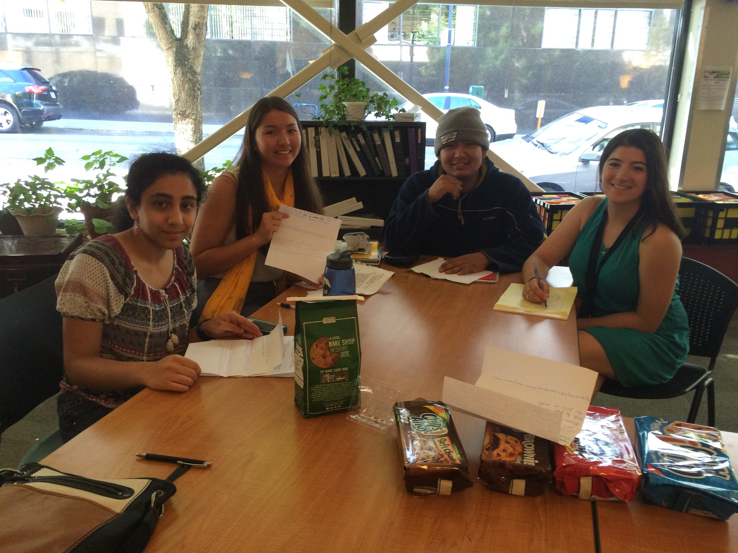Poeteen volunteers Sheila Panyam and Sophia Mautz with Tyler and Jessica from New Avenues at the Poeteen Workshop! A fun day filled with poetry, cookies, and group writing exercises!