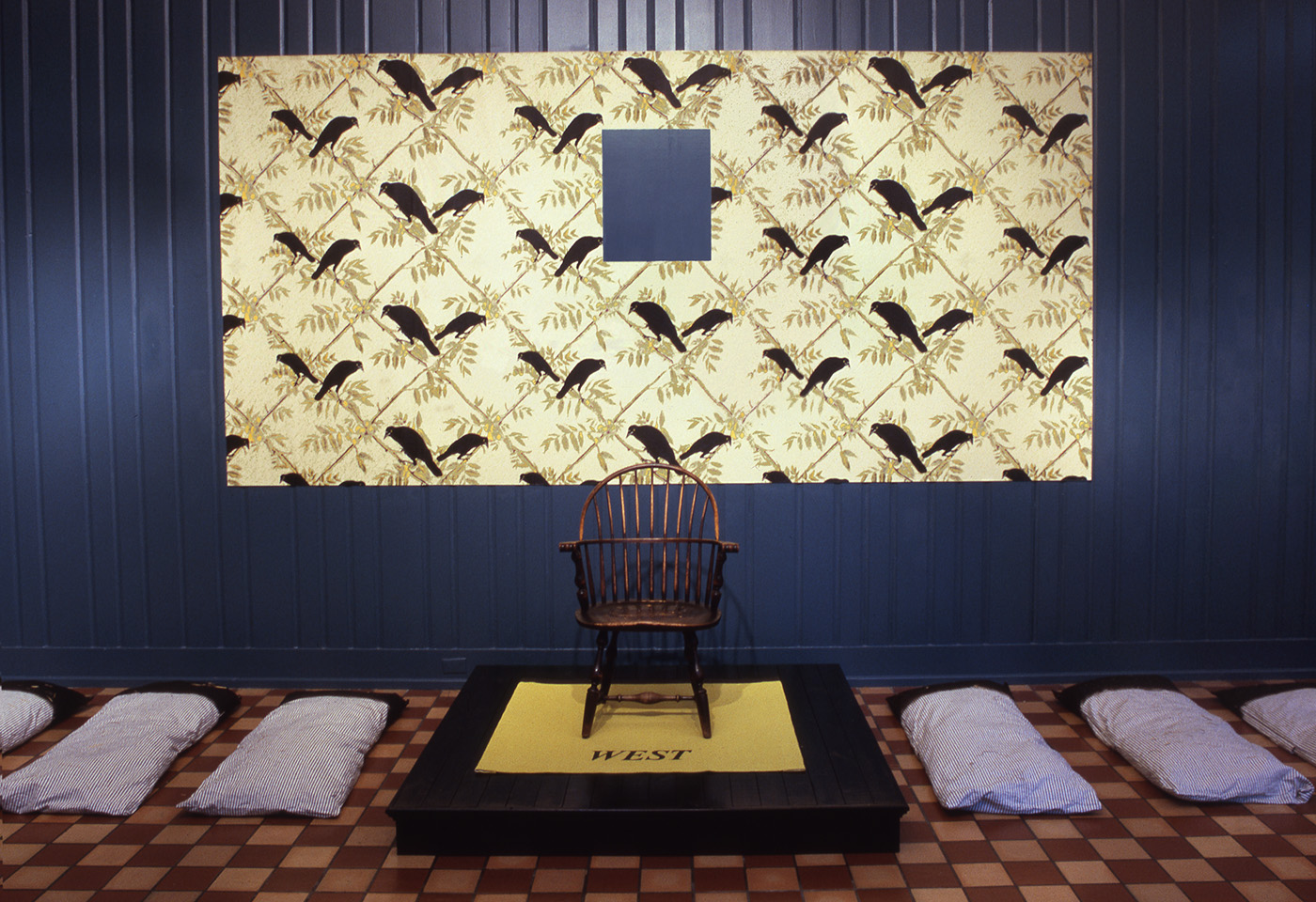 In My Father's House  (Pine Room at University of Virginia Art Museum) 2000 wallpaper, chair and floor-cloth on wood platform, tarred sleeping pallets, dimensions vary
