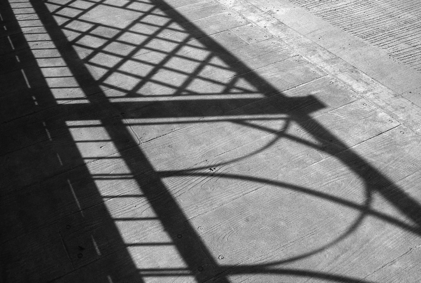 Deck sidewalk  with railing shadow
