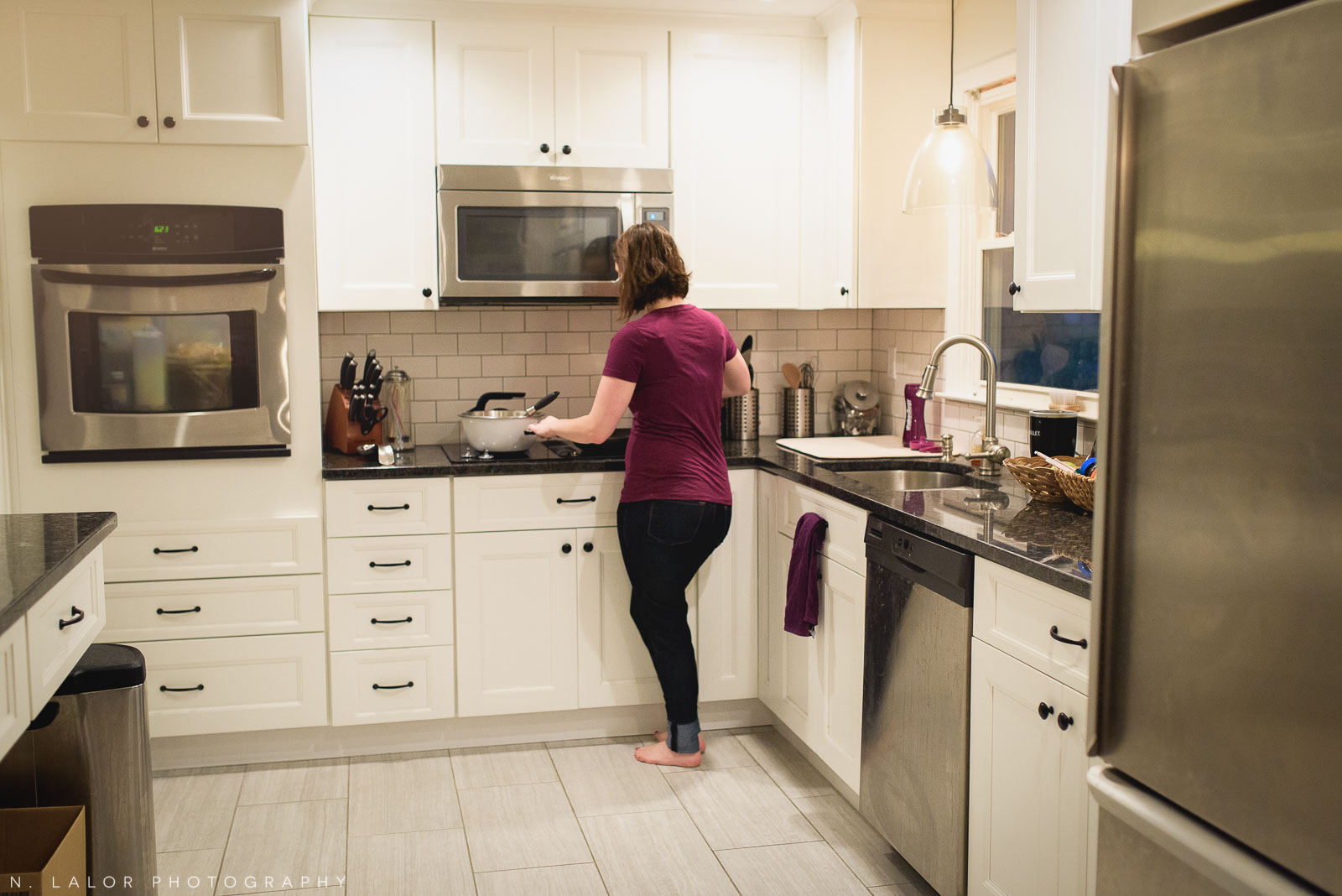 Mom getting breakfast ready in the kitchen, early in the morning. Documentary photo by N. Lalor Photography.