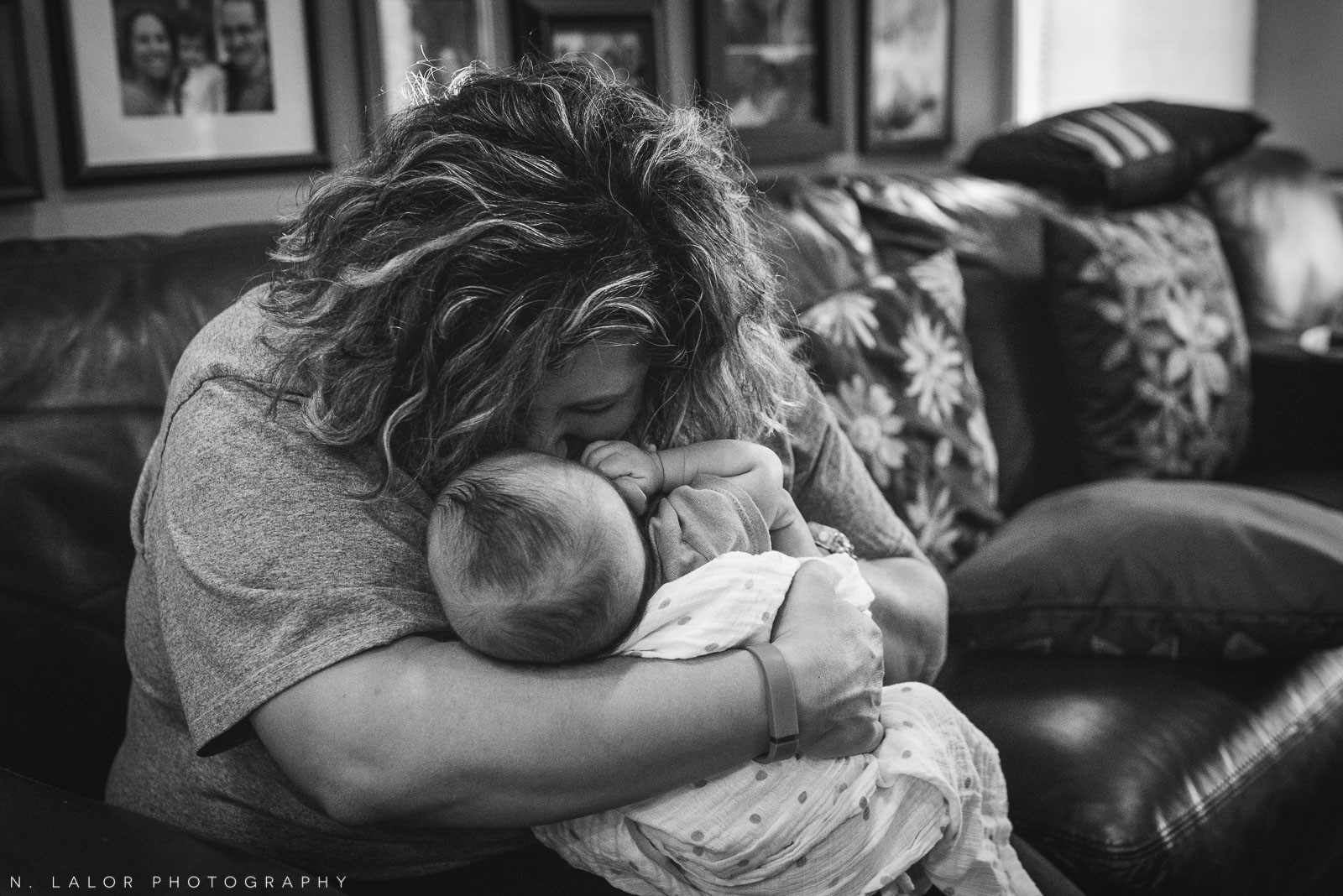 Mom kissing her baby boy. Black and white documentary photograph by N. Lalor Photography.