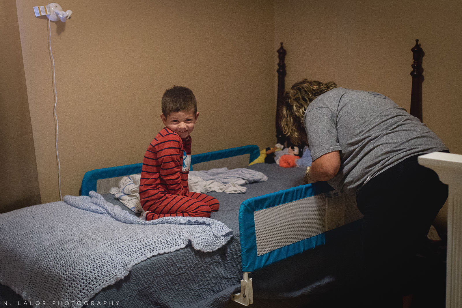 Early morning wakeup for a 4-year old. Documentary photo by N. Lalor Photography.