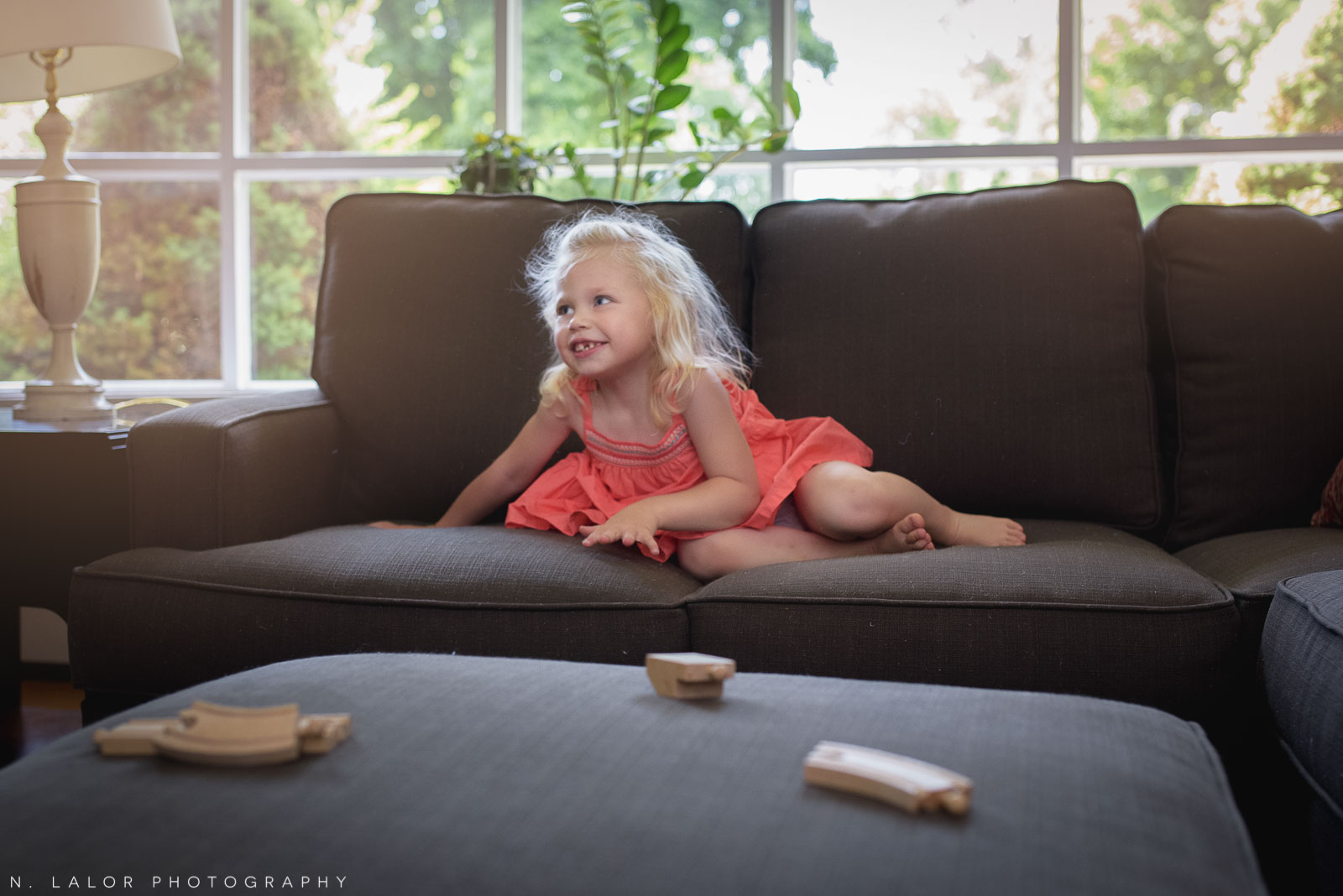Ula has a lot of energy and loves jumping on the couch, which she did a lot of during our photo session. There was no reason to tell her to stop, I simply waited for a quiet moment and got this lovely candid shot of her.