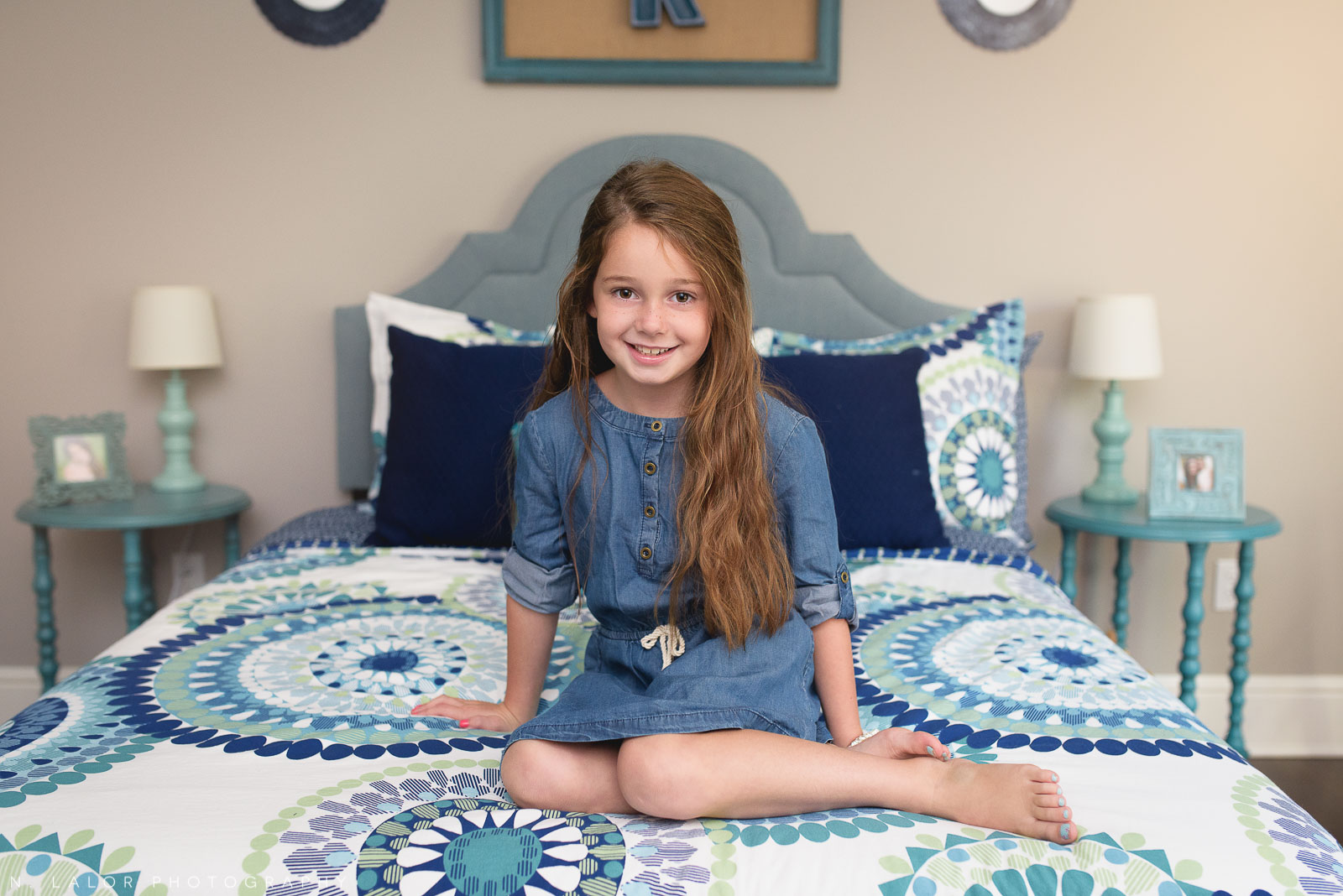 6 year old girl in her beautifully decorated bedroom. Lifestyle portrait by N. Lalor Photography.