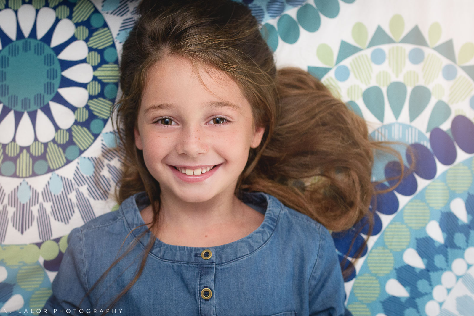 Lifestyle smiling portrait of 6-year old girl. Photo by N. Lalor Photography.