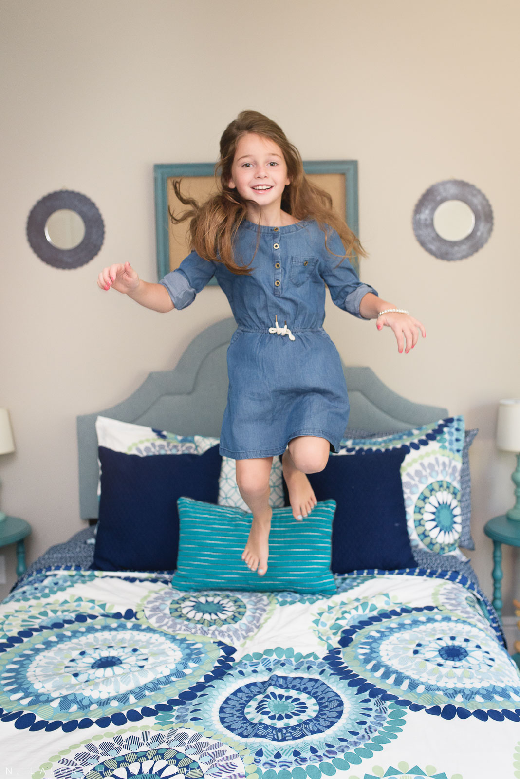 Jumping on the bed. Lifestyle portrait by N. Lalor Photography.