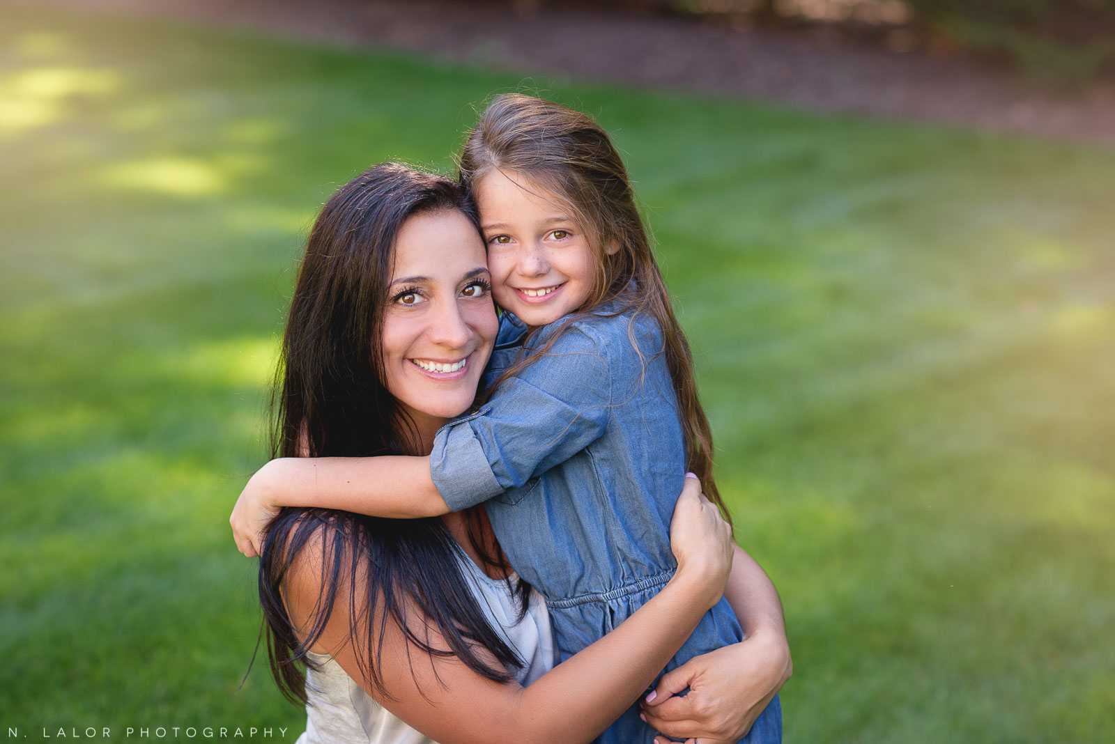 A lifestyle portrait of Mom and her daughter by N. Lalor Photography.