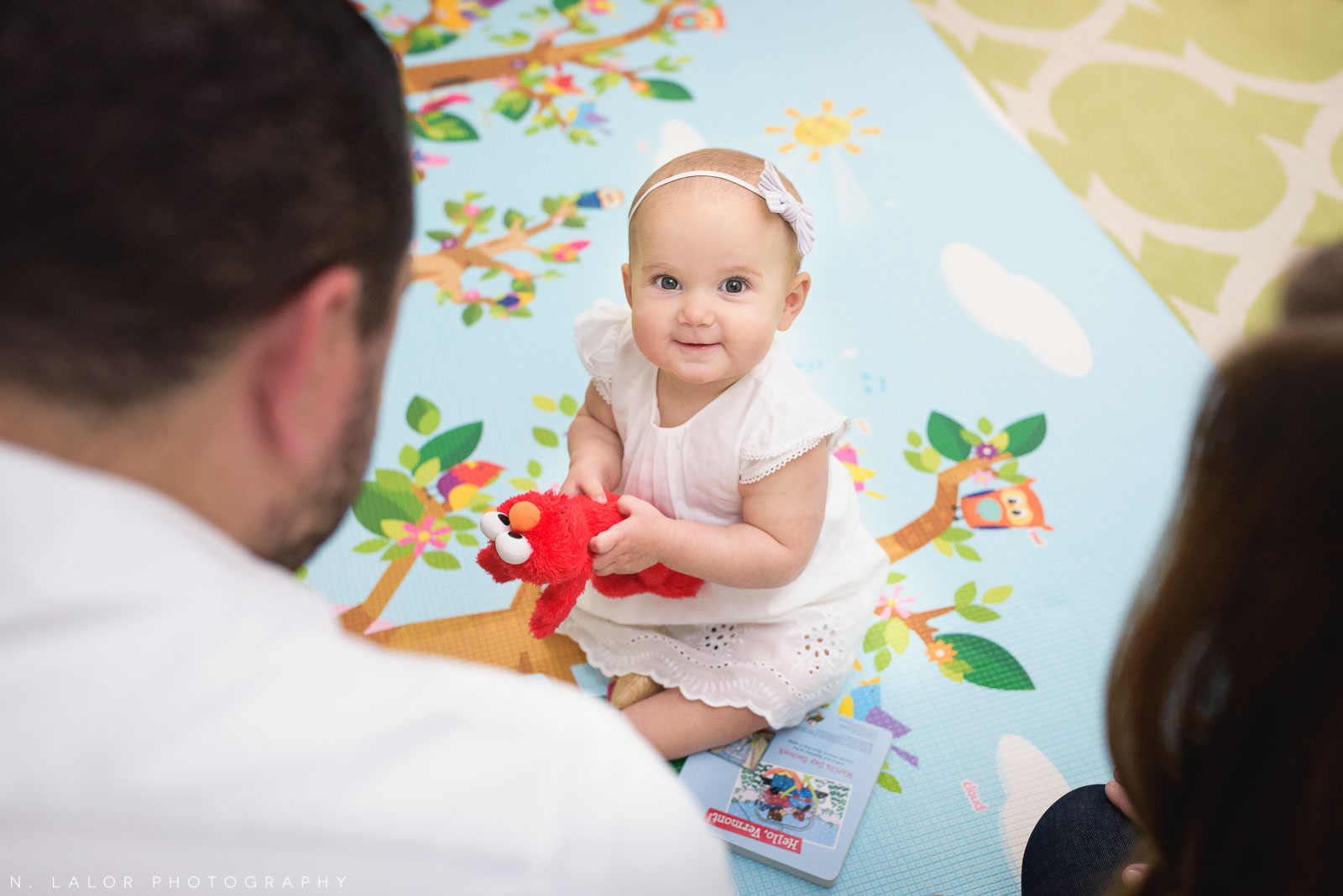 1-year old baby girl in her play room. Lifestyle family photo by N. Lalor Photography.