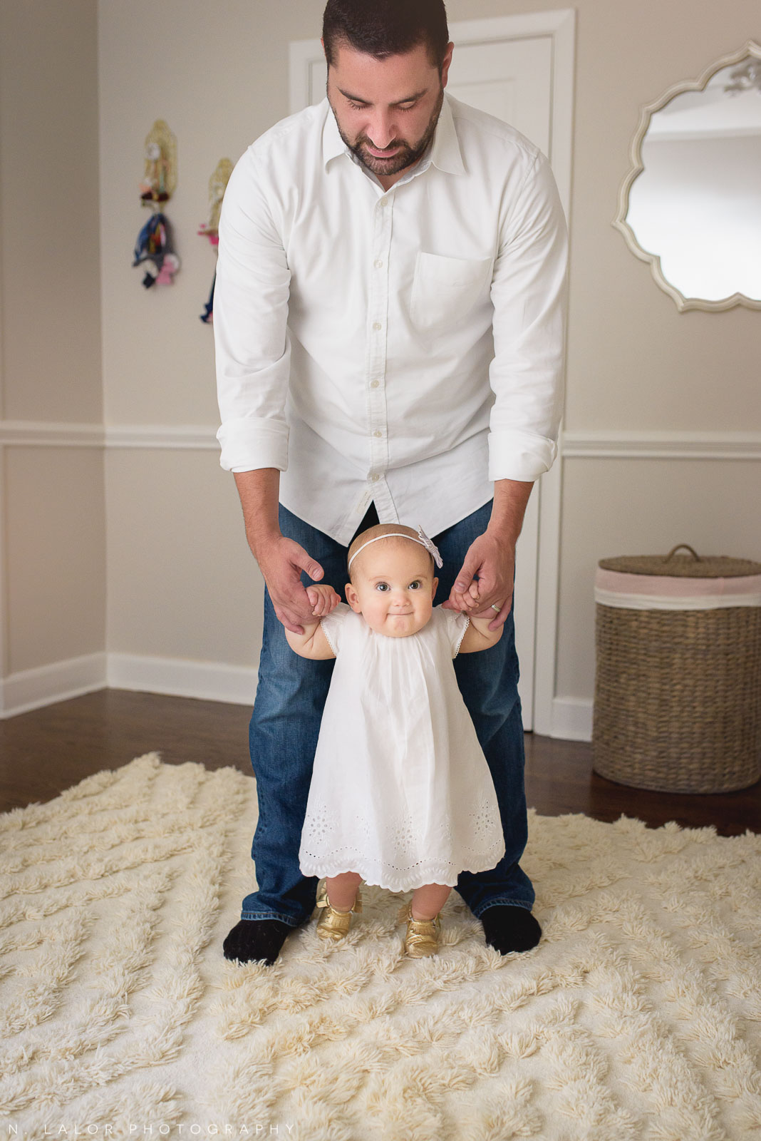 Learning to walk with Dad. Naturally styled family photo by N. Lalor Photography.