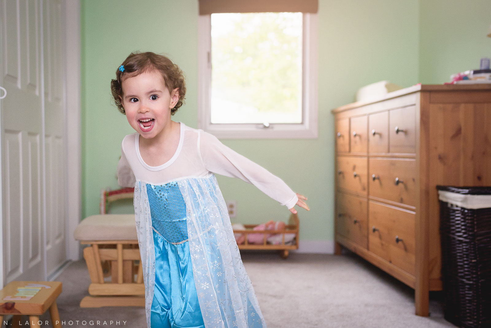 Dancing as Elsa from Frozen. Lifestyle photo by N. Lalor Photography.