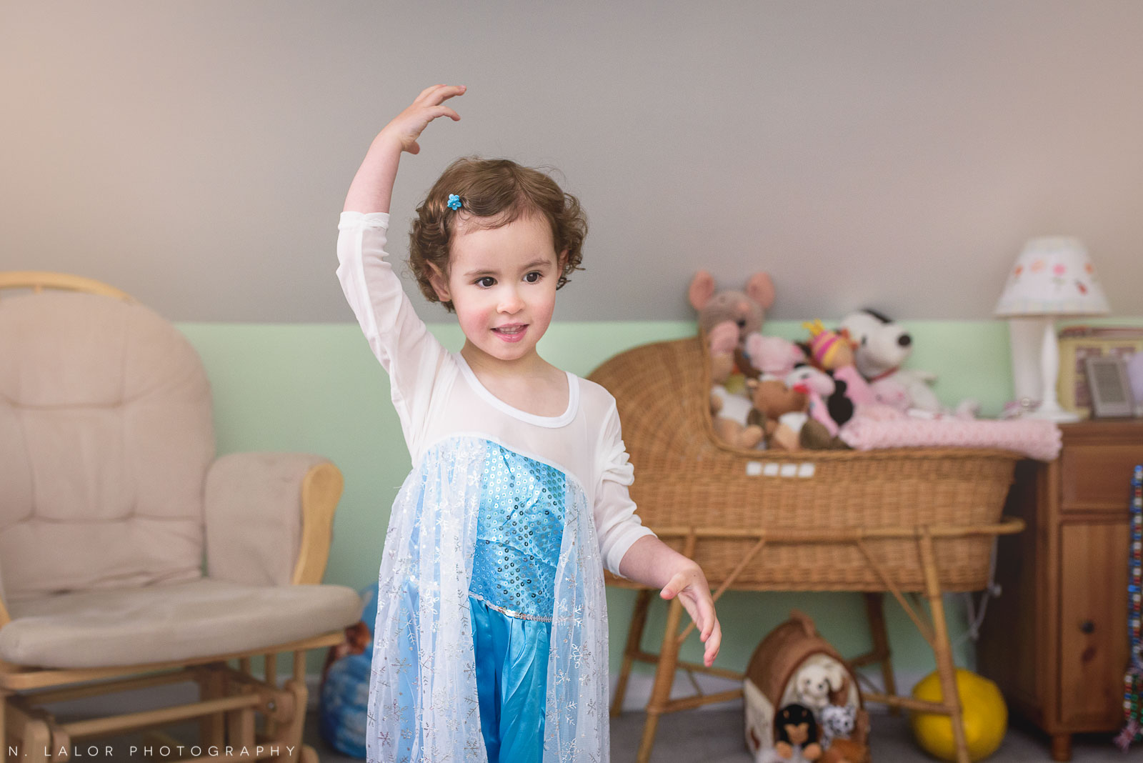 Dancing as Elsa from Frozen. Mini dress-up photo session by N. Lalor Photography.