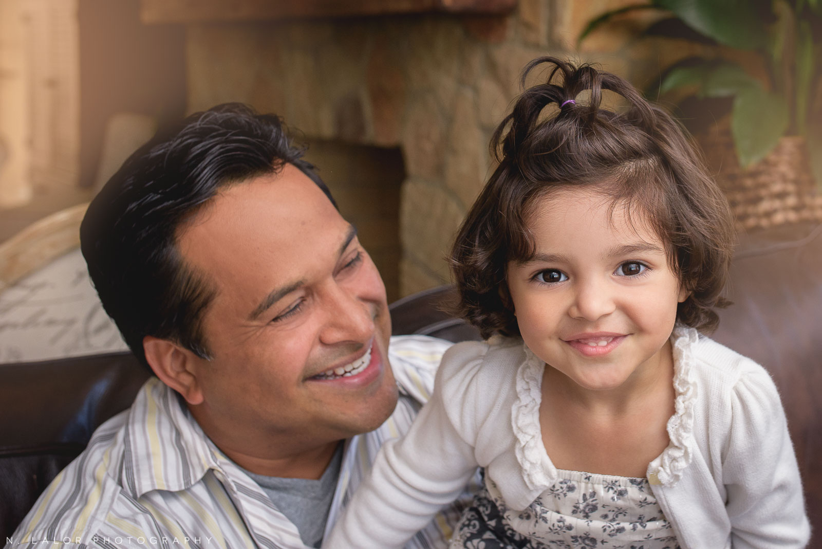 Dad with his daughter. Lifestyle portrait by N. Lalor Photography.