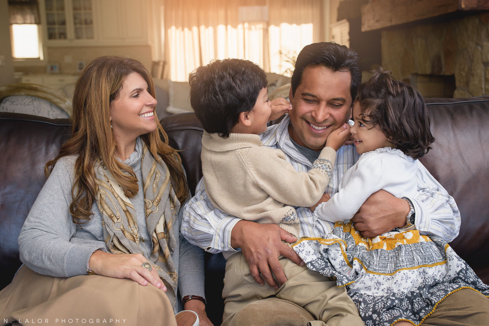 Happy laughing family portrait by N. Lalor Photography. Greenwich CT photographer.