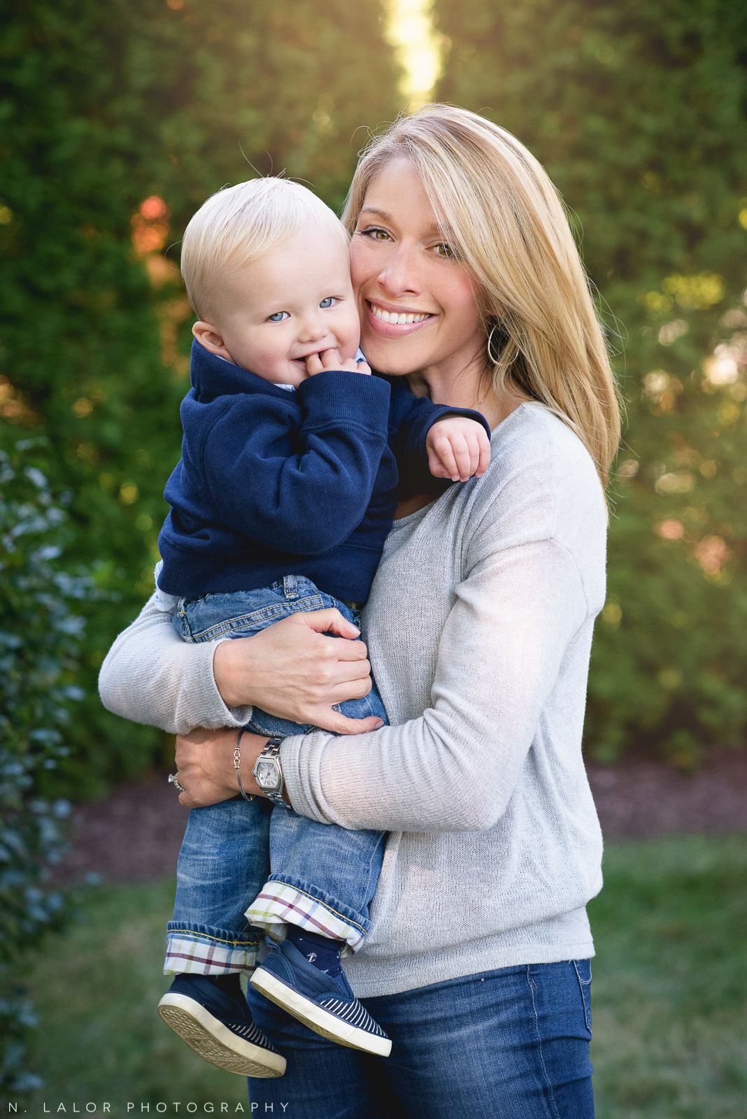 Beautiful Mom with her 1-year old Son. Backyard lifestyle portrait by N. Lalor Photography. Fairfield, CT.