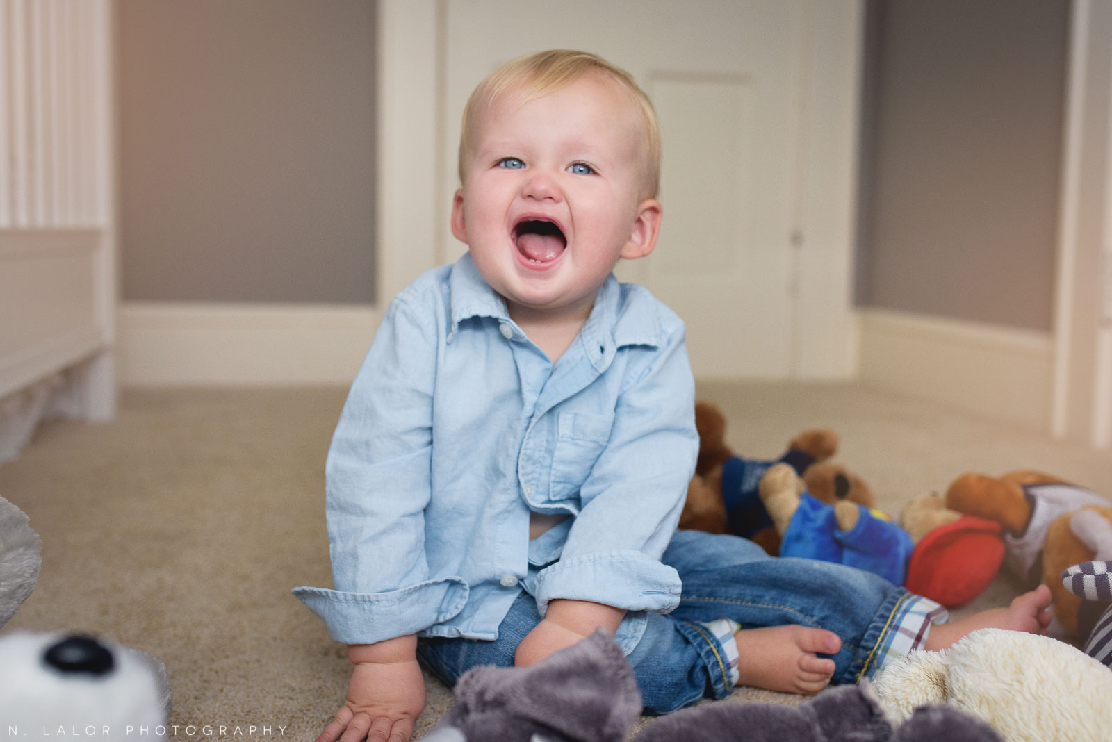 Expression and emotion during a 1-year old photo session. Lifestyle portrait by N. Lalor Photography.
