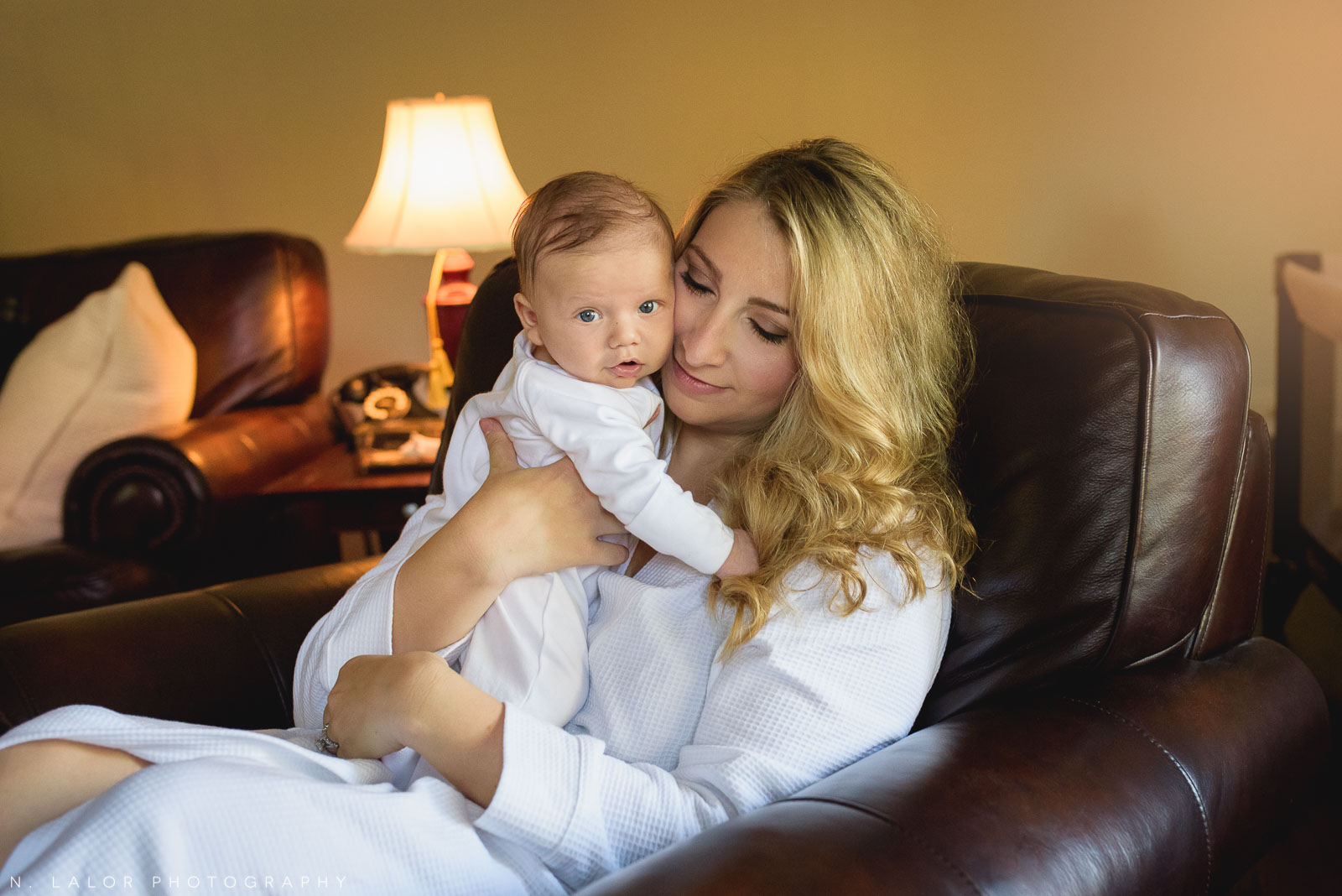 Mom and baby cuddles. In-home photo session with N. Lalor Photography.